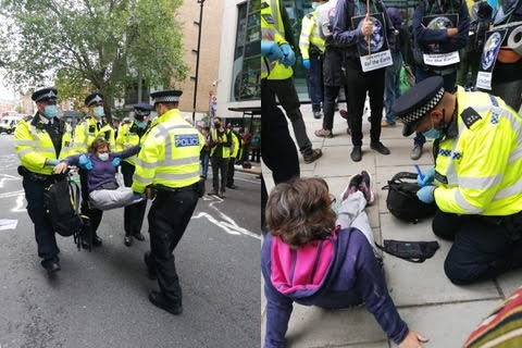 1) Helen being carried away by five police officers.  2) Helen sitting down whilst a police officer takes notes
