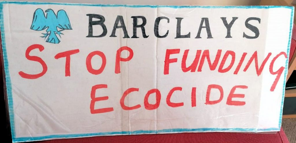 photo of Barclarys Stop Funding Ecocide banner