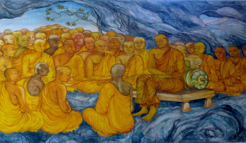 A photograph of a mural showing a group of monks listening to one monk who is sitting on a bench.